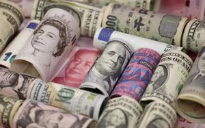 Dollar firm on upbeat US data; pound and euro on the back foot