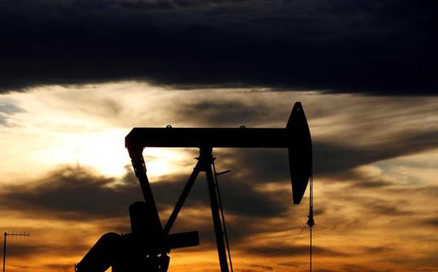 Crude oil prices drop, pressured by stronger US dollar
