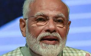 Modi promises ₹50-lakh loan without collateral, welfare board for traders
